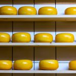round cheese on shelves